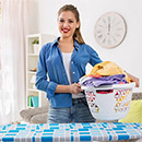 happy-housewife-woman-in-the-laundry-room